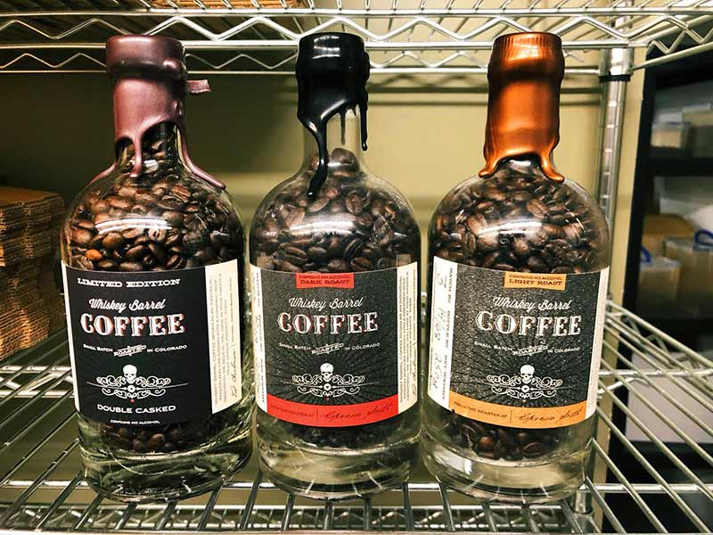 3 Types of Whiskey Barrel Coffee on Shelf in Back