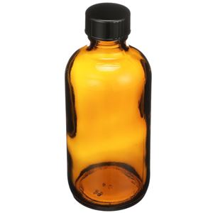 4 oz Amber Glass Nitrogen Purged Boston Round Bottle with Attached Cap - 20-400 Neck Finish - Angled View