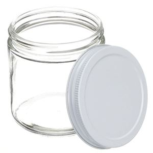 16 oz Clear Glass Round Jar - 89-400 Neck Finish White - Metal Closure Included - Angled View